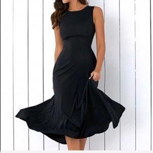 Meiniqi | Classy black swing dress with pockets!